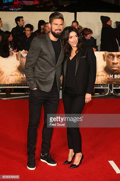Olivier Giroud and Jennifer Giroud attend the World Premiere of 'I Am Bolt' at Odeon Leicester Square on November 28 2016 in London England