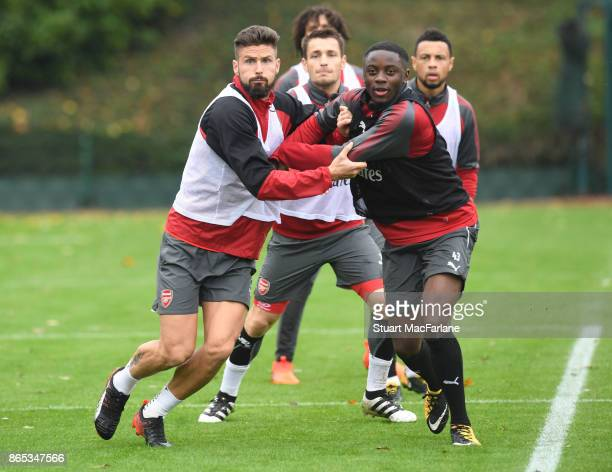 Olivier Giroud and Josh Dasilva of Arsenal during a training session at London Colney on October 23 2017 in St Albans England