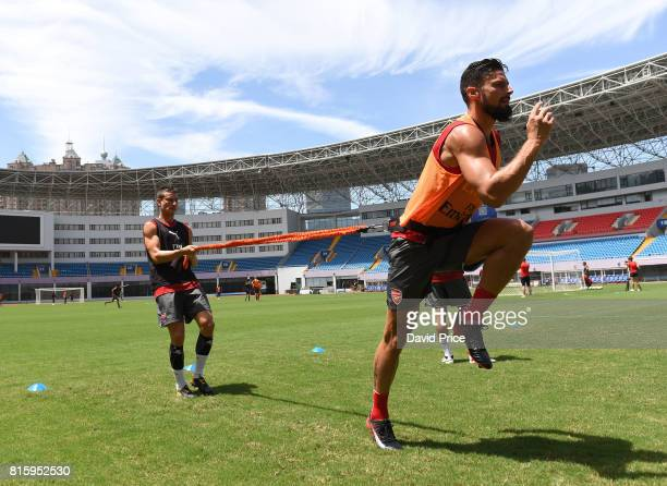 Olivier Giroud and Laurent Koscielny of Arsenal during an Arsenal Training Session at Yuanshen Sports Centre Stadium on July 17 2017 in Shanghai China