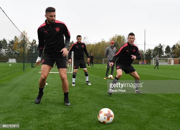 Olivier Giroud and Laurent Koscielny of Arsenal during the Arsenal Training Session at London Colney on October 18 2017 in St Albans England