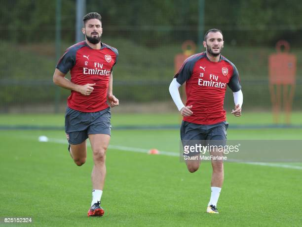 Olivier Giroud and Lucas Perez of Arsenal during a training session at London Colney on August 1 2017 in St Albans England