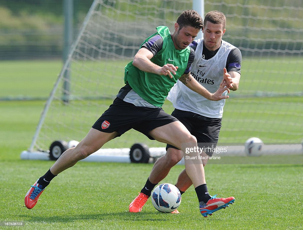Olivier Giroud and Lukas Podolski of Arsenal during a training session at London Colney on April 26, 2013 in St Albans, England.