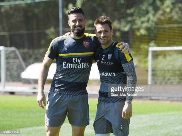 Olivier Giroud and Mathieu Debuchy of Arsenal before a training session at London Colney on May 26 2017 in St Albans England