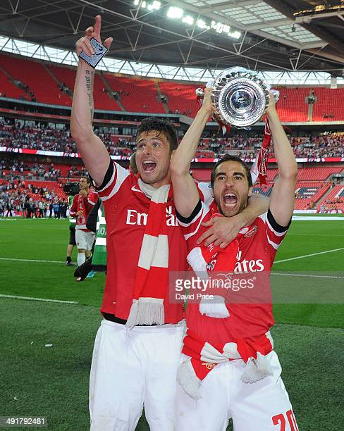 Olivier Giroud and Mathieu Flamini of Arsenal with the FA Cup Trophy after the match between Arsenal and Hull City in the FA Cup Final at Wembley...