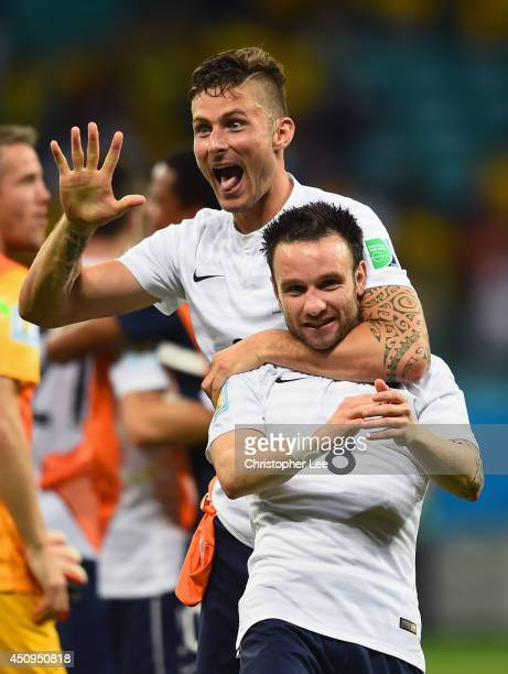 Olivier Giroud and Mathieu Valbuena of France celebrate after defeating Switzerland 52 during the 2014 FIFA World Cup Brazil Group E match between...