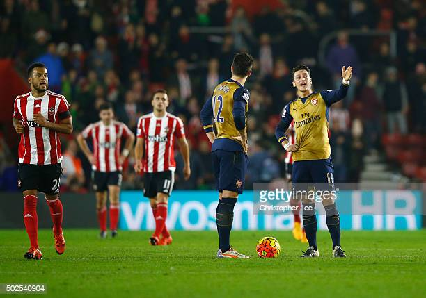 Olivier Giroud and Mesut Ozil of Arsenal in discussion as Southampton score their fourth goal during the Barclays Premier League match between...