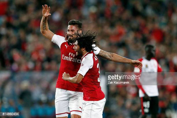 Olivier Giroud and Mohamed Elneny of Arsenal celebrate after Olivier Giroud scored Arsenal's first goal during the match between the Western Sydney...