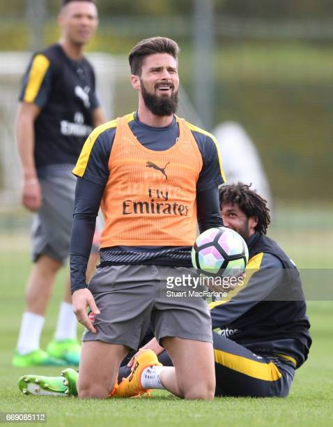 Olivier Giroud and Mohamed Elneny of Arsenal during a training session at London Colney on April 16 2017 in St Albans England
