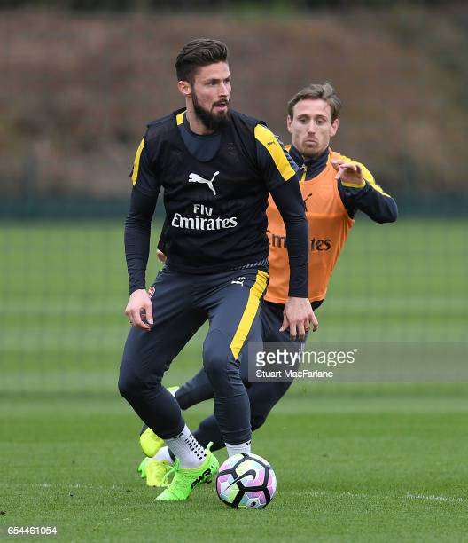 Olivier Giroud and Nacho Monreal of Arsenal during a training session at London Colney on March 17 2017 in St Albans England