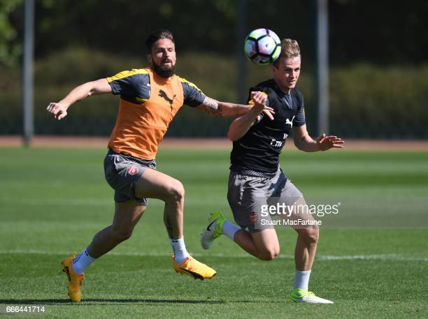 Olivier GIroud and Rob Holding of Arsenal during a training session at London Colney on April 9 2017 in St Albans England