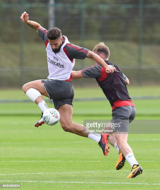 Olivier Giroud and Rob Holding of Arsenal during a training session at London Colney on September 19 2017 in St Albans England