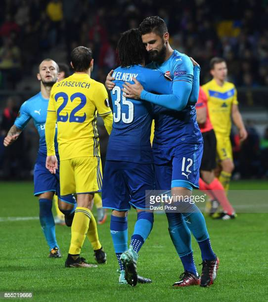 Olivier Giroud celebartes scoring Arsenal's fourth goal with Mohamed Elneny during the UEFA Europa League group H match between BATE Borisov and...
