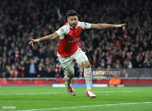 Olivier Giroud celebrates scoring a goal for Arsenal during the UEFA Champions League match between Arsenal and Bayern Munich at Emirates Stadium on...