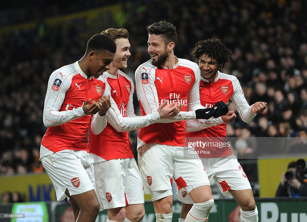 Olivier Giroud celebrates scoring a goal for Arsenal with Alex Iwobi, Calum Chambers and Mohamed Elneny during the match between Hull City and Arsenal in the FA Cup 5th round at KC Stadium on March 8, 2016 in Hull, England.
