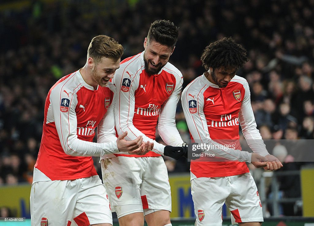Olivier Giroud celebrates scoring a goal for Arsenal with Calum Chambers and Mohamed Elneny during the match between Hull City and Arsenal in the FA Cup 5th round at KC Stadium on March 8, 2016 in Hull, England.