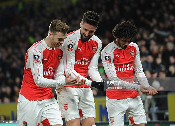 Olivier Giroud celebrates scoring a goal for Arsenal with Calum Chambers and Mohamed Elneny during the match between Hull City and Arsenal in the FA...