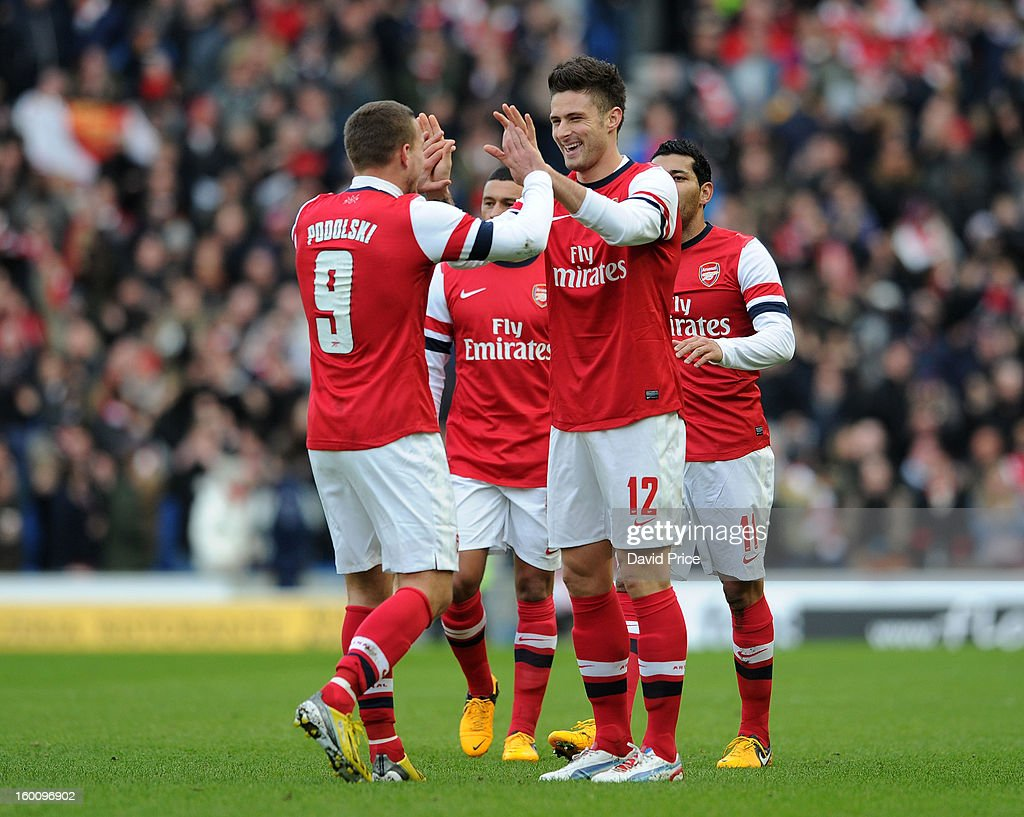 <a gi-track='captionPersonalityLinkClicked' href=/galleries/search?phrase=Olivier+Giroud&family=editorial&specificpeople=5678034 ng-click='$event.stopPropagation()'>Olivier Giroud</a> celebrates scoring Arsenal's 1st goal with lukas Podolski of Arsenal during the FA Cup Fourth Round match between Brighton & Hove Albion and Arsenal at the Amex Stadium on January 26, 2013 in Brighton, England.