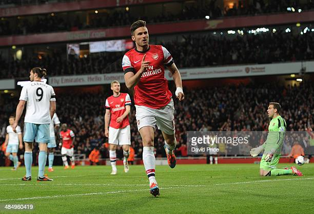 Olivier Giroud celebrates scoring Arsenal's 2nd goal during the match between Arsenal and West Ham United in the Barclays Premier League at Emirates...