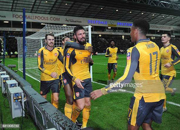Olivier Giroud celebrates scoring Arsenal's 2nd goal with Alex Iwobi and Aaron Ramsey during the match between Preston North End and Arsenal at...
