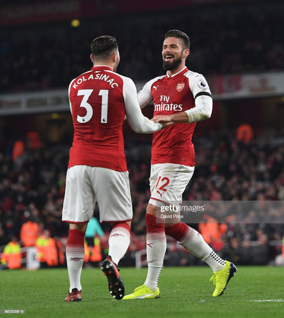 Olivier Giroud celebrates scoring Arsenal's 5th goal with Sead Kolasinac during the Premier League match between Arsenal and Huddersfield Town at Emirates Stadium on November 29, 2017 in London, England.