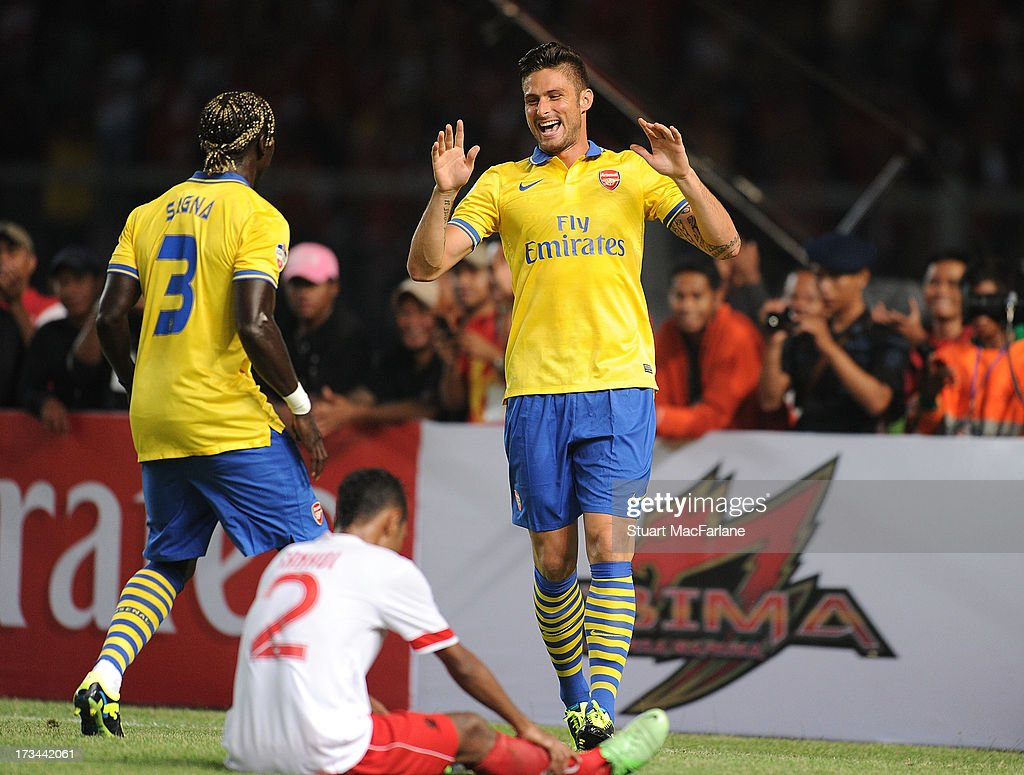 <a gi-track='captionPersonalityLinkClicked' href=/galleries/search?phrase=Olivier+Giroud&family=editorial&specificpeople=5678034 ng-click='$event.stopPropagation()'>Olivier Giroud</a> celebrates scoring his 1st goal with <a gi-track='captionPersonalityLinkClicked' href=/galleries/search?phrase=Bacary+Sagna&family=editorial&specificpeople=745680 ng-click='$event.stopPropagation()'>Bacary Sagna</a> during the match between Arsenal and the Indonesia All-Stars at Gelora Bung Karno Stadium on July 14, 2013 in Jakarta, Indonesia.