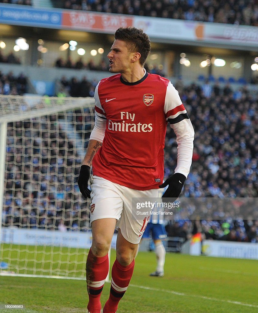 Olivier Giroud celebrates scoring the 2nd Arsenal goal during the FA Cup Fourth Round match between Brighton & Hove Albion and Arsenal at the Amex Stadium on January 26, 2013 in Brighton, England.