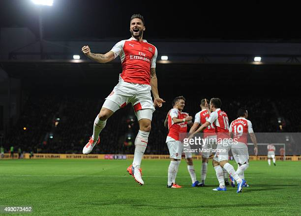 Olivier Giroud celebrates scoring the 2nd Arsenal goal during the Barclays Premier League match between Watford and Arsenal at Vicarage Road on...