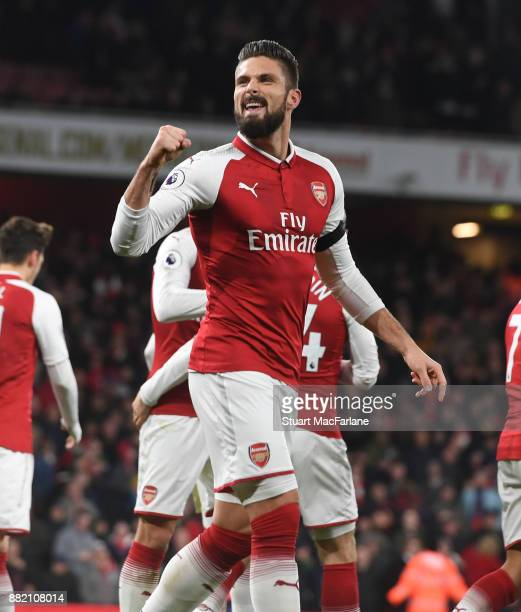 Olivier Giroud celebrates scoring the 2nd Arsenal goal during the Premier League match between Arsenal and Huddersfield Town at Emirates Stadium on...