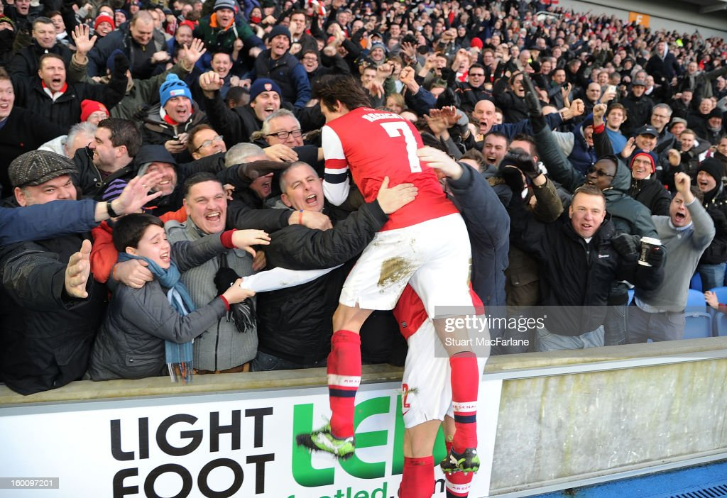Olivier Giroud (Hidden) celebrates scoring the 2nd goal with Tomas Rosicky (7) and the Arsenal fans during the FA Cup Fourth Round match between Brighton & Hove Albion and Arsenal at the Amex Stadium on January 26, 2013 in Brighton, England.