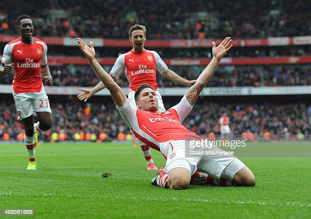 Olivier Giroud celebrates scoring the 4th Arsenal goal during the Barclays Premier League match between Arsenal and Liverpool at Emirates Stadium on...