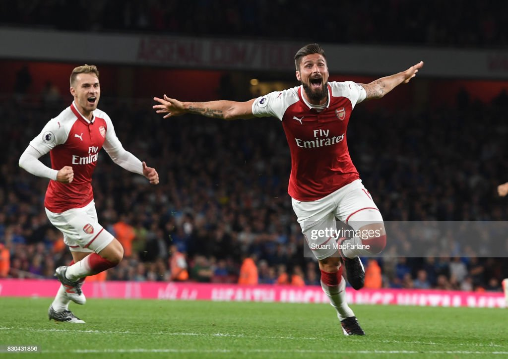 Olivier Giroud celebrates scoring the 4th Arsenal goal during the Premier League match between Arsenal and Leicester City at Emirates Stadium on August 11, 2017 in London, England.