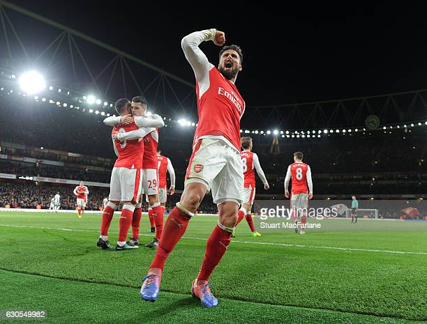 Olivier Giroud celebrates scoring the Arsenal goal during the Premier League match between Arsenal and West Bromwich Albion at Emirates Stadium on...