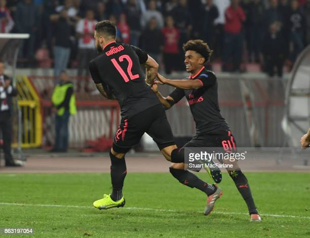 Olivier Giroud celebrates scoring the Arsenal goal with Reiss Nelson during the UEFA Europa League group H match between Crvena Zvezda and Arsenal FC...