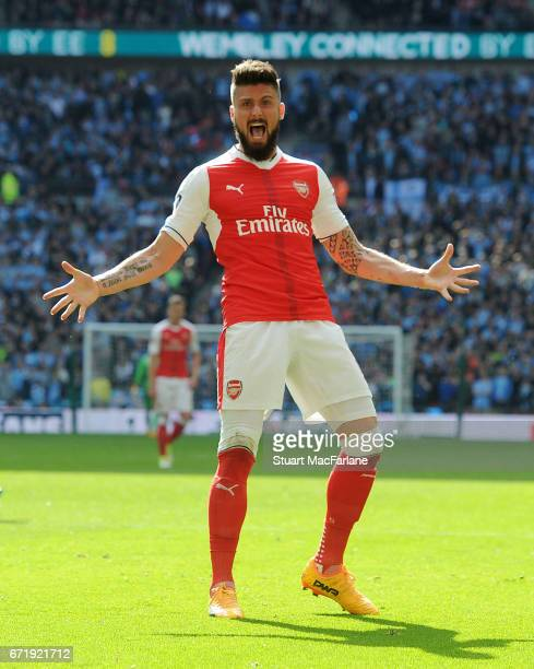Olivier Giroud celebrates the 1st Arsenal goal during the Emirates FA Cup SemiFinal match between Arsenal and Manchester City at Wembley Stadium on...