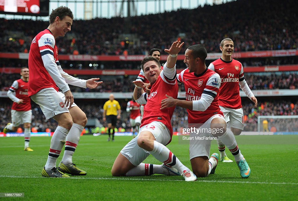 Olivier Giroud (C) celebrates with team-mates Theo Walcott and Laurent Koscielny (L) after scoring their team's third goal during the Barclays Premier League match between Arsenal and Tottenham Hotspur, at Emirates Stadium on November 17, 2012 in London, England.