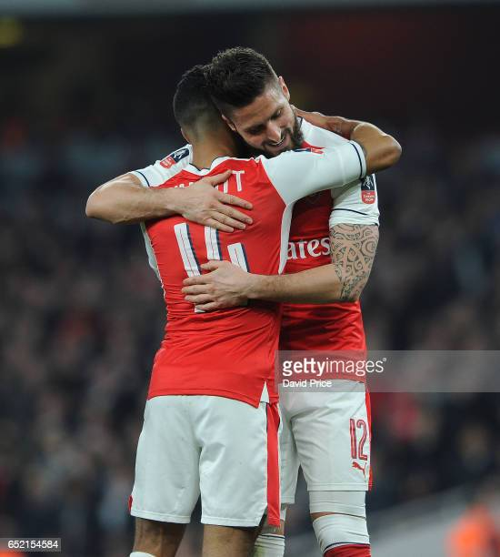 Olivier Giroud celebtrates scoring Arsenal's 2nd goal with Theo Walcott during the match between Arsenal and Lincoln City at Emirates Stadium on...