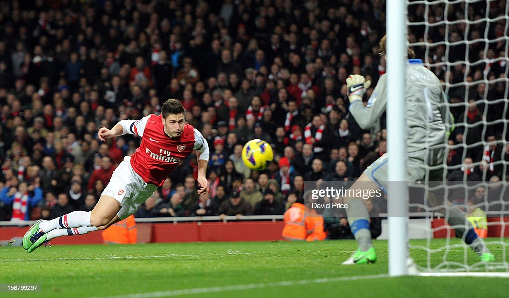 Olivier Giroud heads Arsenal's 5th goal past Tim Krul of Newcastle during the Barclays Premier League match between Arsenal and Newcastle United at Emirates Stadium on December 29, 2012 in London, England.