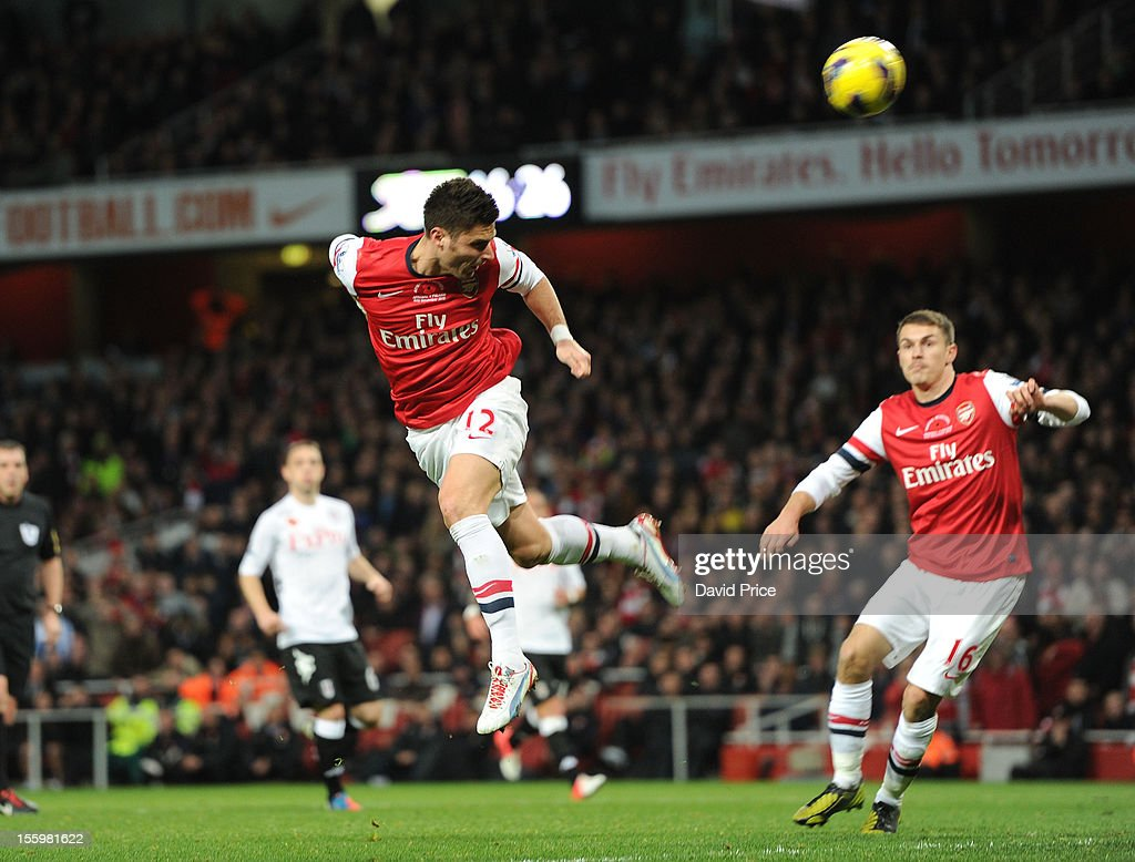 <a gi-track='captionPersonalityLinkClicked' href=/galleries/search?phrase=Olivier+Giroud&family=editorial&specificpeople=5678034 ng-click='$event.stopPropagation()'>Olivier Giroud</a> heads his 2nd goal Arsenal's 3rd during the Barclays Premier League match between Arsenal and Fulham, at Emirates Stadium on November 10, 2012 in London, England.