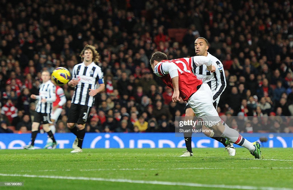 Olivier Giroud heads past Newcastle goalkeeper Tim Krul for the 5th Arsenal goal during the Barclays Premier League match between Arsenal and Newcastle United at Emirates Stadium on December 29, 2012 in London, England.