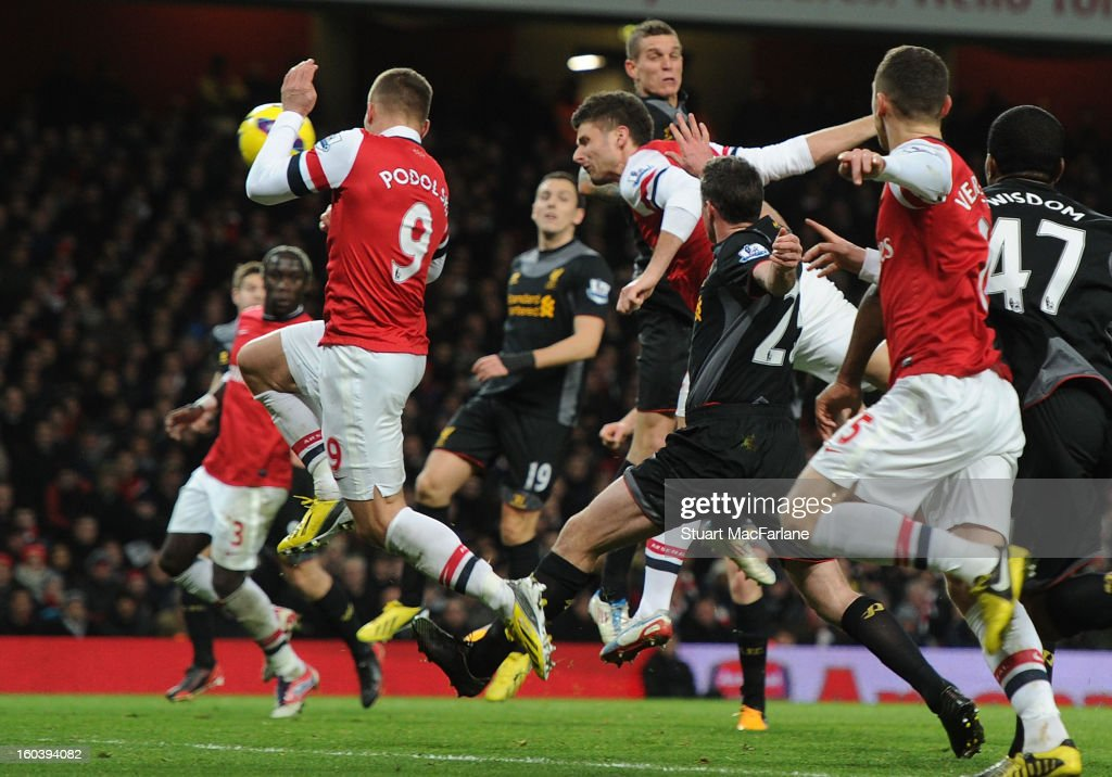 <a gi-track='captionPersonalityLinkClicked' href=/galleries/search?phrase=Olivier+Giroud&family=editorial&specificpeople=5678034 ng-click='$event.stopPropagation()'>Olivier Giroud</a> heads though a crowded penalty area to score the 1st Arsenal goal during the Barclays Premier League match between Arsenal and Liverpool at Emirates Stadium on January 30, 2013 in London, England.