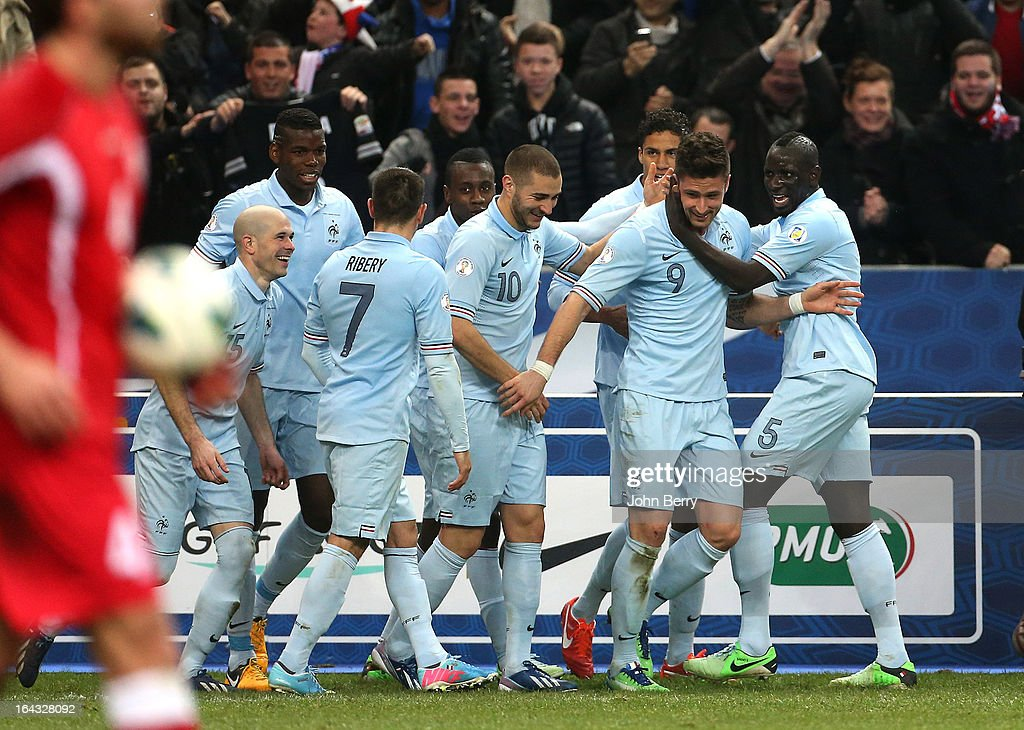 <a gi-track='captionPersonalityLinkClicked' href=/galleries/search?phrase=Olivier+Giroud&family=editorial&specificpeople=5678034 ng-click='$event.stopPropagation()'>Olivier Giroud</a> (2nd R) is congratulated by team-mates <a gi-track='captionPersonalityLinkClicked' href=/galleries/search?phrase=Mamadou+Sakho&family=editorial&specificpeople=4154099 ng-click='$event.stopPropagation()'>Mamadou Sakho</a> (R), <a gi-track='captionPersonalityLinkClicked' href=/galleries/search?phrase=Karim+Benzema&family=editorial&specificpeople=796089 ng-click='$event.stopPropagation()'>Karim Benzema</a>, <a gi-track='captionPersonalityLinkClicked' href=/galleries/search?phrase=Raphael+Varane&family=editorial&specificpeople=7365948 ng-click='$event.stopPropagation()'>Raphael Varane</a>, <a gi-track='captionPersonalityLinkClicked' href=/galleries/search?phrase=Christophe+Jallet&family=editorial&specificpeople=2264495 ng-click='$event.stopPropagation()'>Christophe Jallet</a>, <a gi-track='captionPersonalityLinkClicked' href=/galleries/search?phrase=Paul+Pogba&family=editorial&specificpeople=5805302 ng-click='$event.stopPropagation()'>Paul Pogba</a> and <a gi-track='captionPersonalityLinkClicked' href=/galleries/search?phrase=Franck+Ribery&family=editorial&specificpeople=490869 ng-click='$event.stopPropagation()'>Franck Ribery</a> after scoring the opening goal of the FIFA 2014 World Cup qualifier match between France and Georgia at the Stade de France on March 22, 2013 in Saint-Denis near Paris, France.