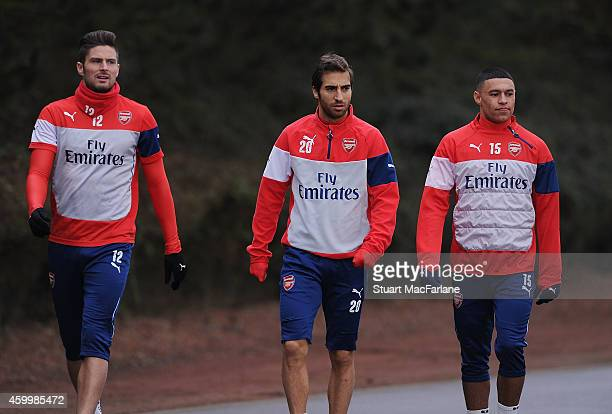Olivier Giroud Mathieu Flamini and Alex OxladeChamberlain of Arsenal before a training session at London Colney on December 5 2014 in St Albans...