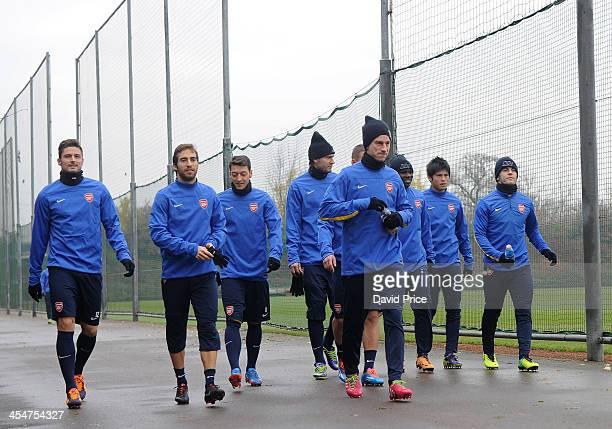 Olivier Giroud Mathieu Flamini Mesut Ozil Nicklas Bendtner Laurent Koscienly Emmanuel Frimpong Ryo Miyaichi and Jack Wilshere of Arsenal before the...