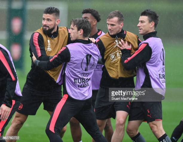 Olivier Giroud Nacho Monreal Rob Holding and Laurent Koscielny of Arsenal during a training session at London Colney on October 18 2017 in St Albans...