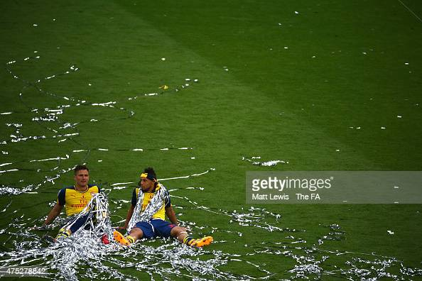 Olivier Giroud of Arsenal and his teammate Francis Coquelin celebrate on the pitch after winning the FA Cup Final between Aston Villa and Arsenal at...