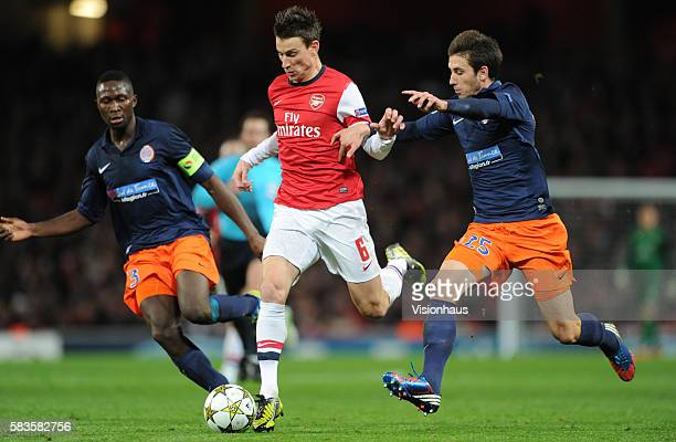 Olivier Giroud of Arsenal and Mathieu Deplagne and Mapou YangaMbiwa of Montpellier Herault SC during the UEFA Champions League Group B match between...