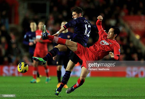 Olivier Giroud of Arsenal and Maya Yoshida of Southampton compete for the ball during the Barclays Premier league match between Southampton and...
