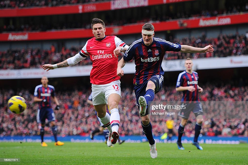 Olivier Giroud of Arsenal and Robert Huth of Stoke City compete for the ball during the Barclays Premier League match between Arsenal and Stoke City at Emirates Stadium on February 2, 2013 in London, England.