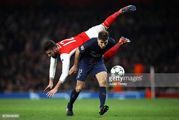 Olivier Giroud of Arsenal and Thomas Meunier of PSG battle for possession during the UEFA Champions League Group A match between Arsenal FC and Paris...