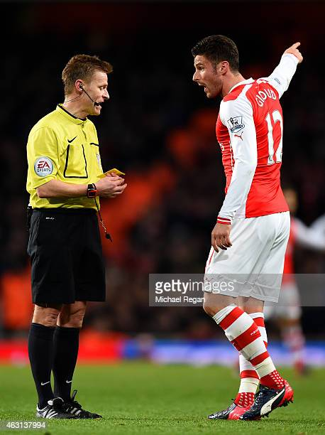 Olivier Giroud of Arsenal argues with referee Mike Jones during the Barclays Premier League match between Arsenal and Leicester City at Emirates...